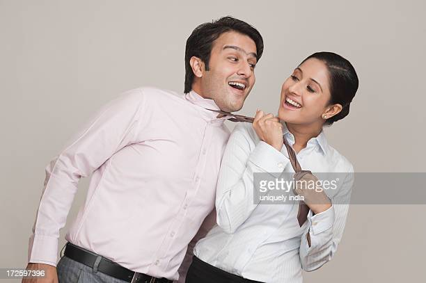 Businesswoman flirting with a businessman in an office