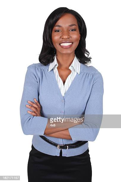 Businesswoman folding arms and smiling