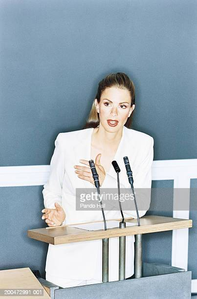 Businesswoman giving presentation at lectern