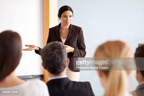 Businesswoman giving presentation at meeting