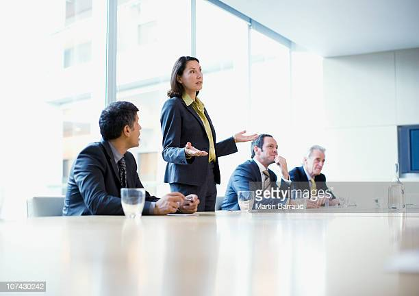 Businesswoman giving presentation in conference room