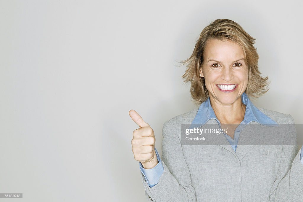 Businesswoman giving thumbs-up