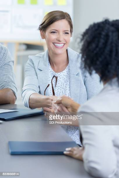 Businesswoman greets potential new employee