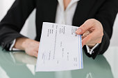 Close-up Photo Of Businesswoman Hand Giving Cheque