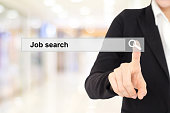 Businesswoman hand touching job search on search bar over blur background, business and technology concept, search engine optimization, web banner