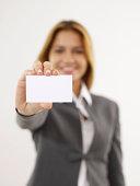 Businesswoman Handing Business Card