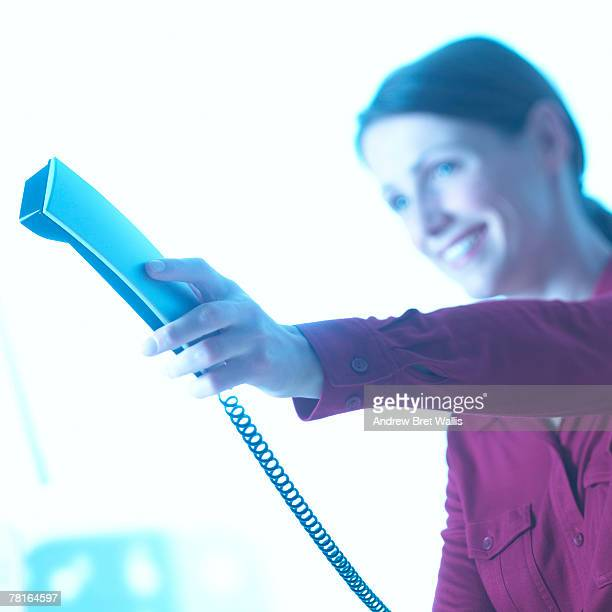 Businesswoman handing phone