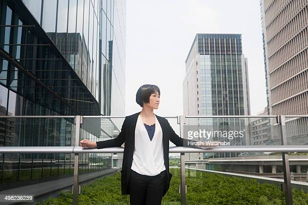 Businesswoman has a break in the rooftop garden