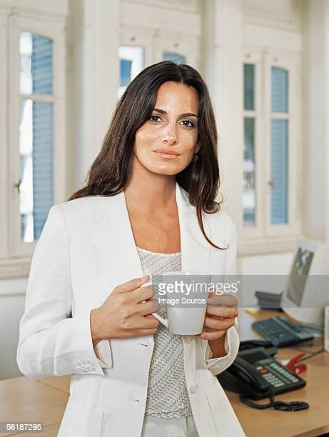 Businesswoman having a coffee