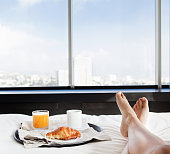 Businesswoman having breakfast in bed