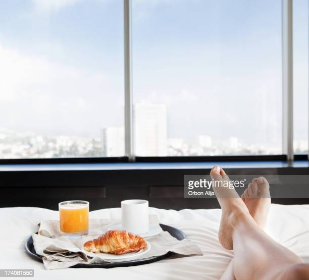 Businesswoman having breakfast in bed