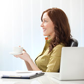 Businesswoman Having Coffee Break.