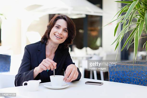 Businesswoman having coffee in cafe