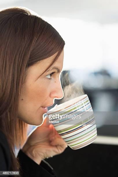 Businesswoman having coffee in office