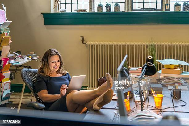 Businesswoman having internet break in office