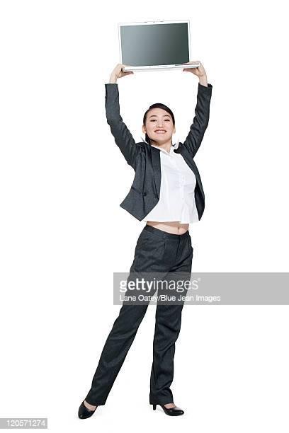 A businesswoman holding a computer