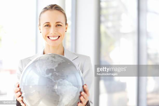 Businesswoman Holding a Globe