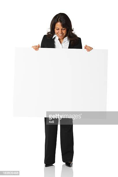 Businesswoman holding a placard