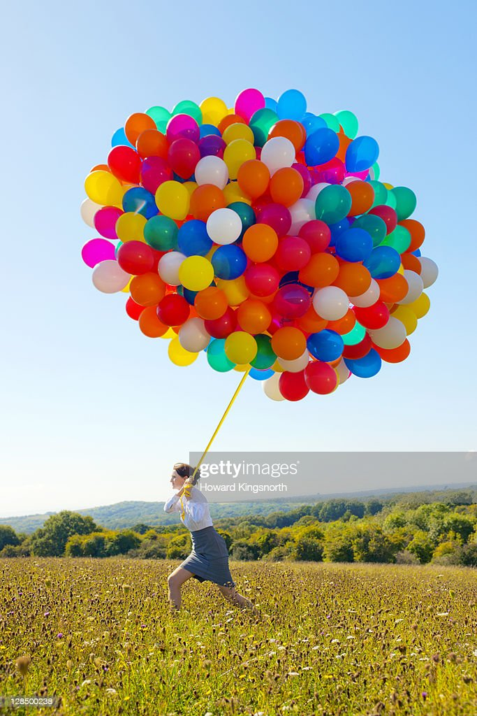 businesswoman holding big bunch of balloons : Stock Photo