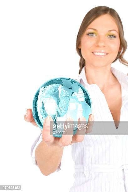 Businesswoman holding blue globe