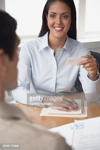 Businesswoman holding business card : Foto de stock