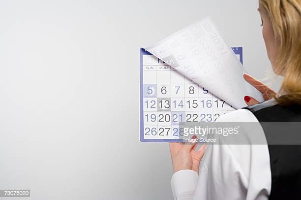 Businesswoman holding calendar