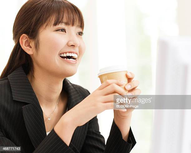 Businesswoman Holding Coffee