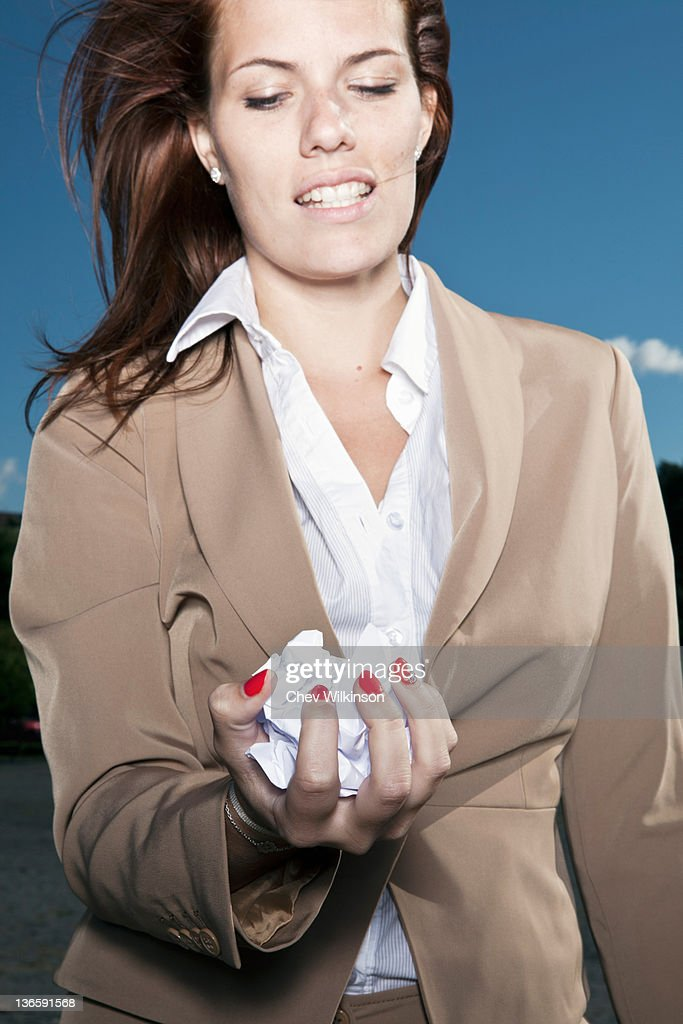 Businesswoman holding crumpled paper : Stock Photo