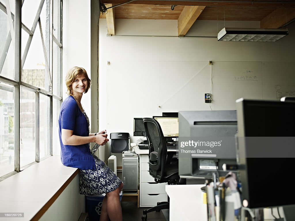 Businesswoman holding digital tablet in office : Stock Photo