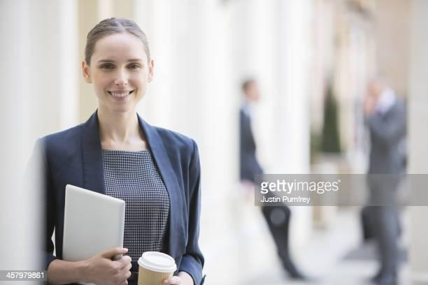 Businesswoman holding digital tablet