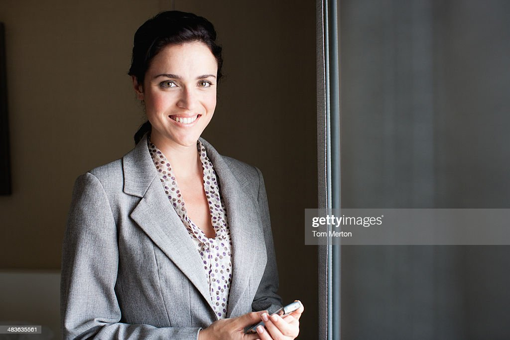 Businesswoman holding electronic organizer