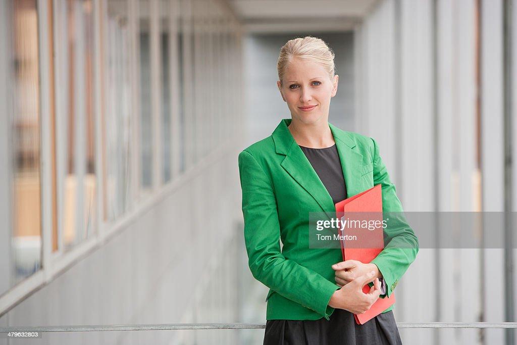 Businesswoman holding file