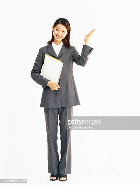 Businesswoman holding files, portrait