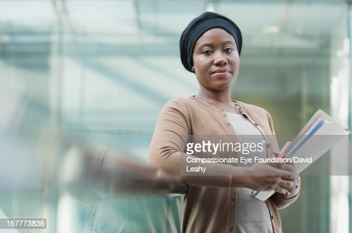 Businesswoman holding folder in office