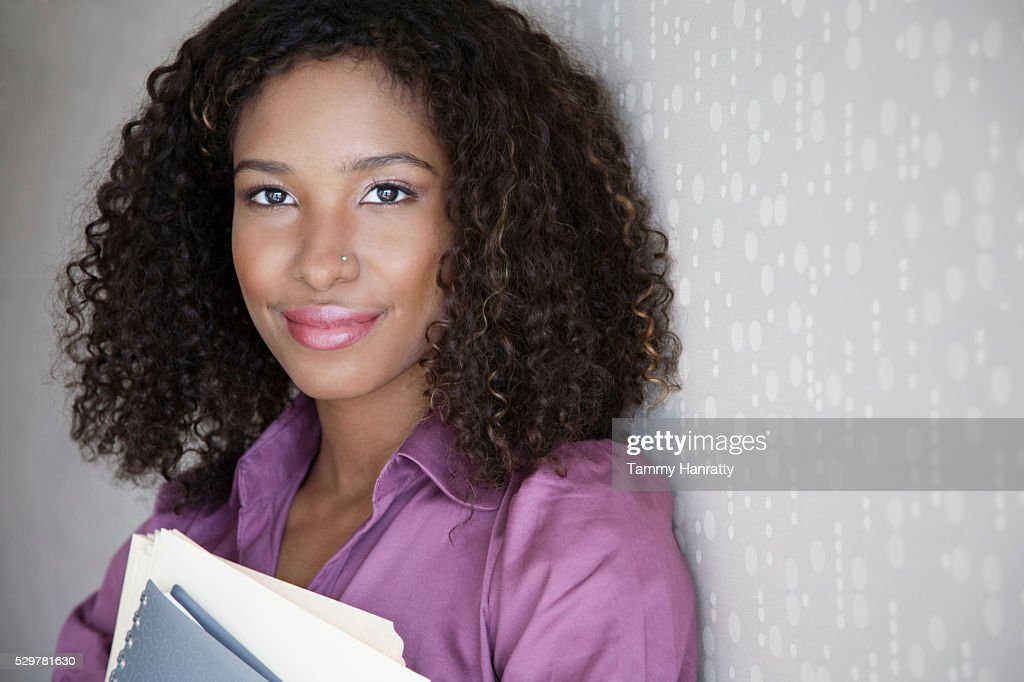 Businesswoman holding folders : Stock Photo