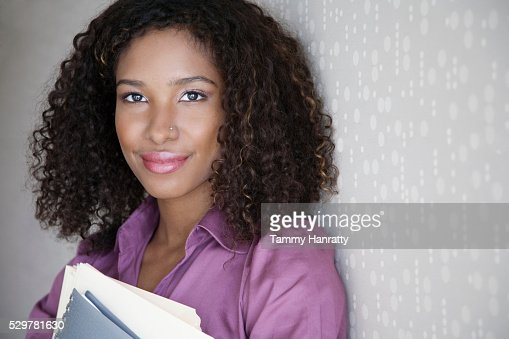 Businesswoman holding folders : Bildbanksbilder
