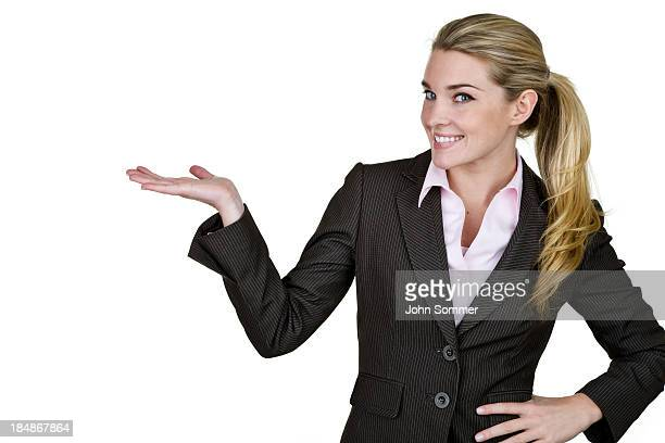 Businesswoman holding hand open for copy space