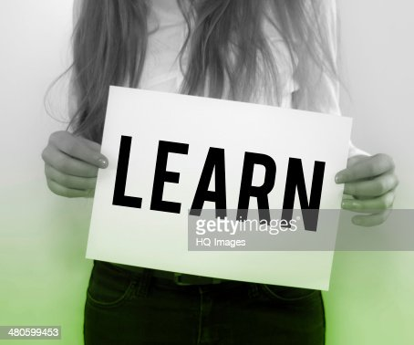 Businesswoman Holding Learn on Paper : Stock Photo