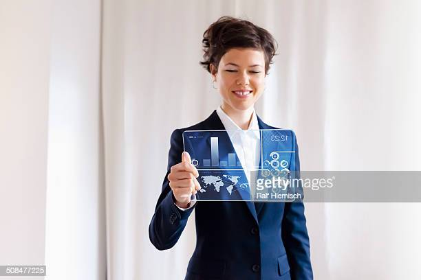 Businesswoman Holding Modern Blank Electronic Digital Tablet With Graph