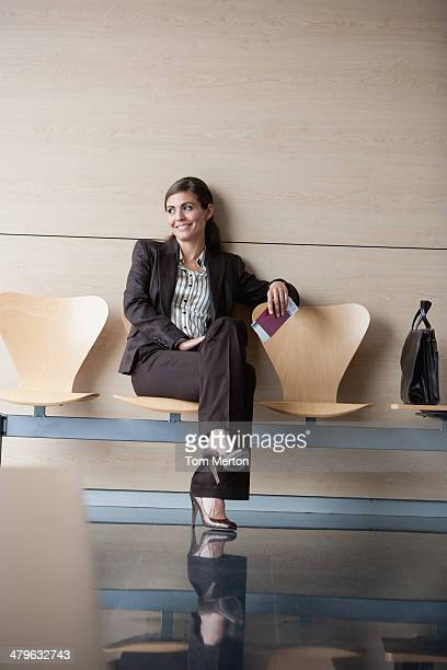 Businesswoman holding passport and airline ticket