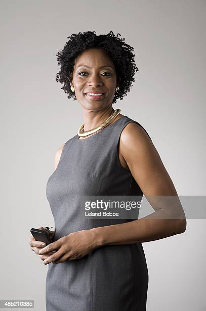 Businesswoman holding smartphone