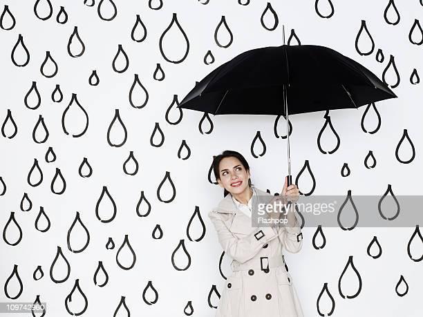 Businesswoman holding umbrella