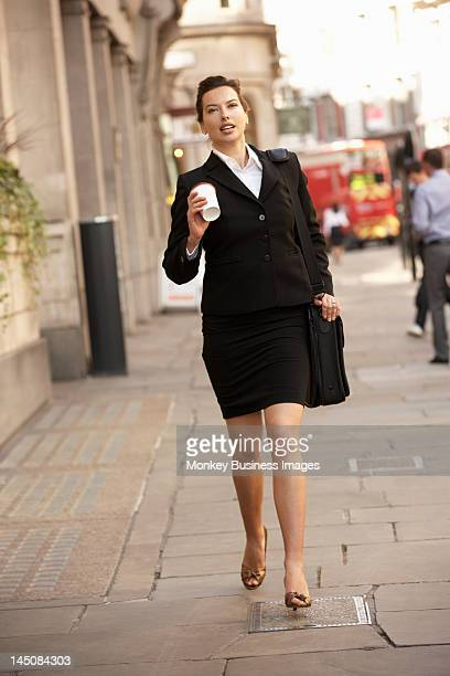 Businesswoman hurrying to work