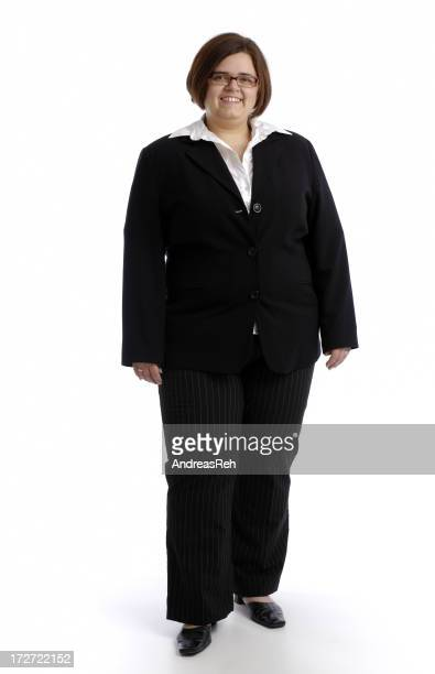 Businesswoman in a black suit on a white background