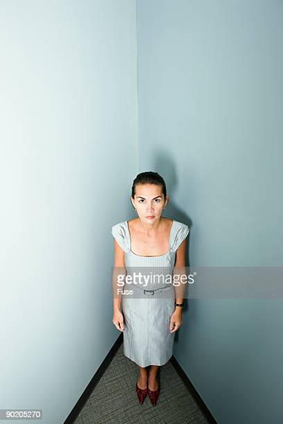 Businesswoman in a corner