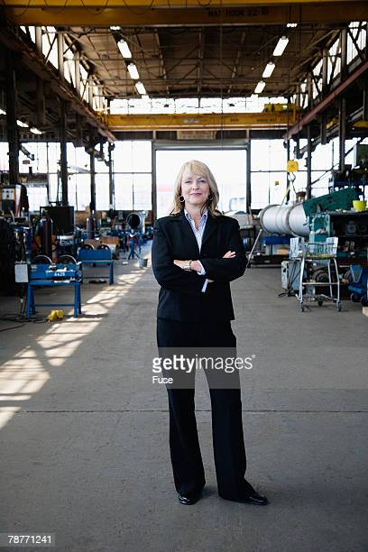Businesswoman in a Factory