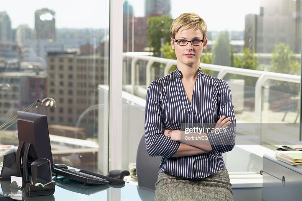 Businesswoman In Corner Office With View Stock Photo | Getty Images