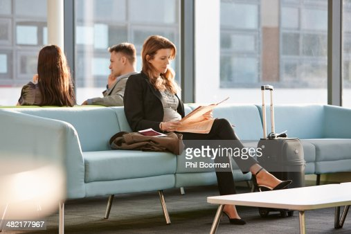 Businesswoman in departure lounge