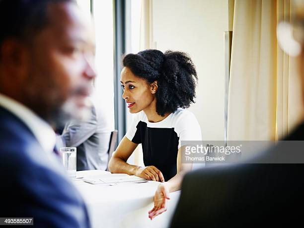 Businesswoman in discussion at table in restaurant