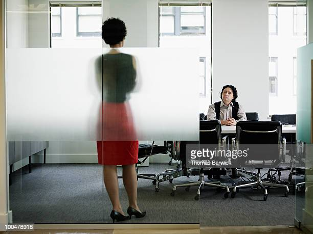 Businesswoman in discussion with businessman